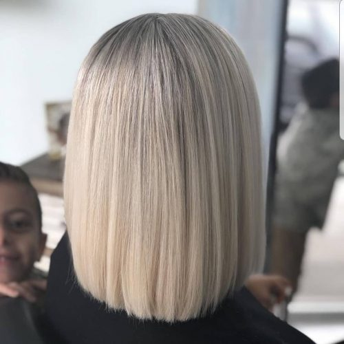 Picture of a perfectly straight ash blonde shoulder length hair