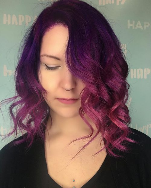 Picture of a pink and purple curled hairstyle