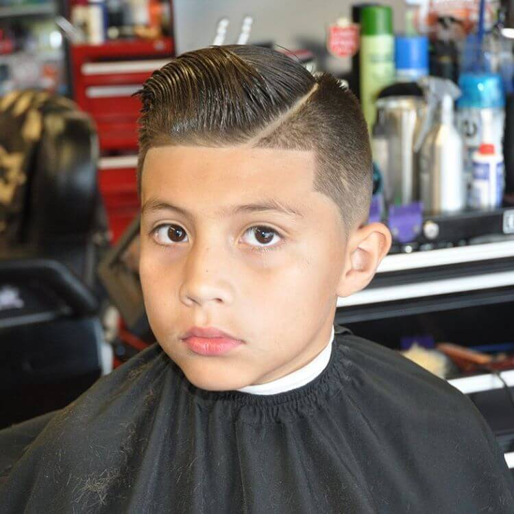 A modern pomp line up haircut for boys with a line