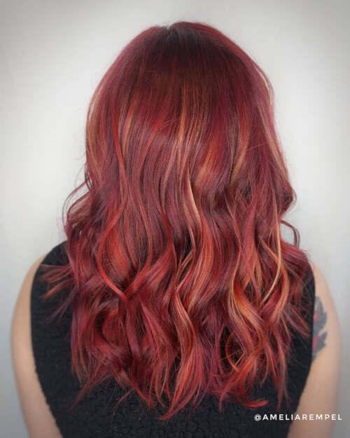 pops of red and violet hair color