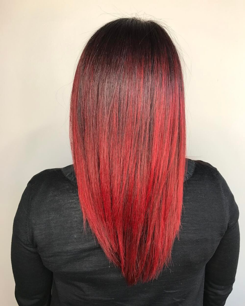 Medium layered haircut with a black to red ombre hair color