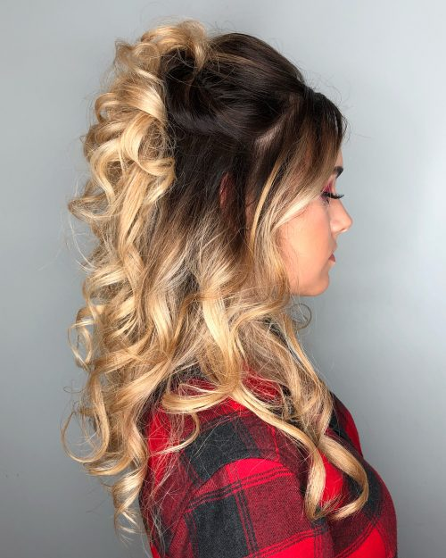 A brown to blonde ombre half up half down curls for prom