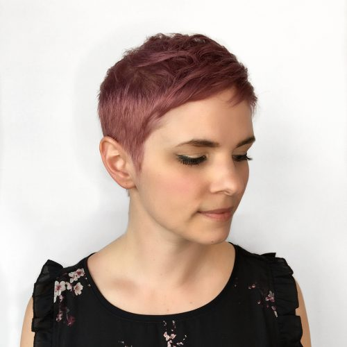 Rose gold hair color on short pixie haircut