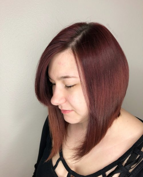 Picture of a rosewood red inverted shoulder length bob