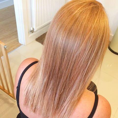 Elegant blonde with subtle strawberry reddish tones