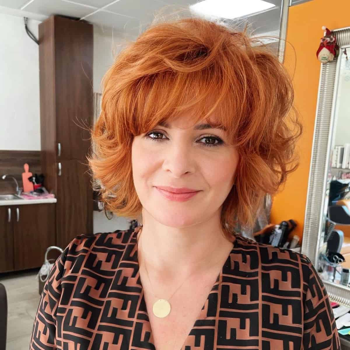 Rounded bob with wispy bangs for over 40
