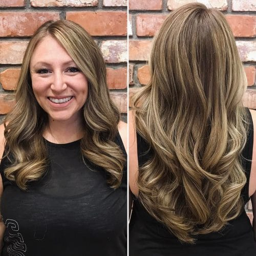A long hairstyle with curls and blonde highlights