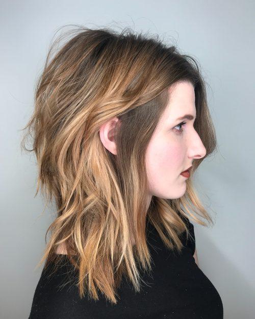 Shaggy hair with blonde highlights