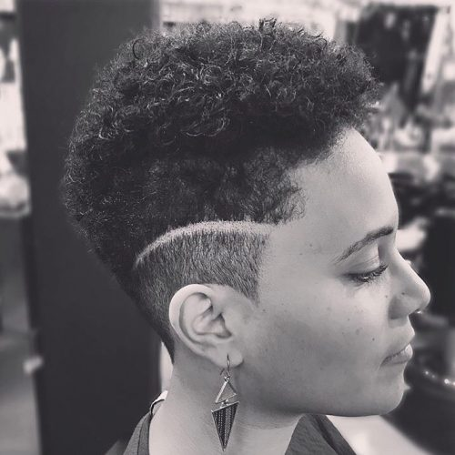 Picture of a women with a short disconnected fade haircut