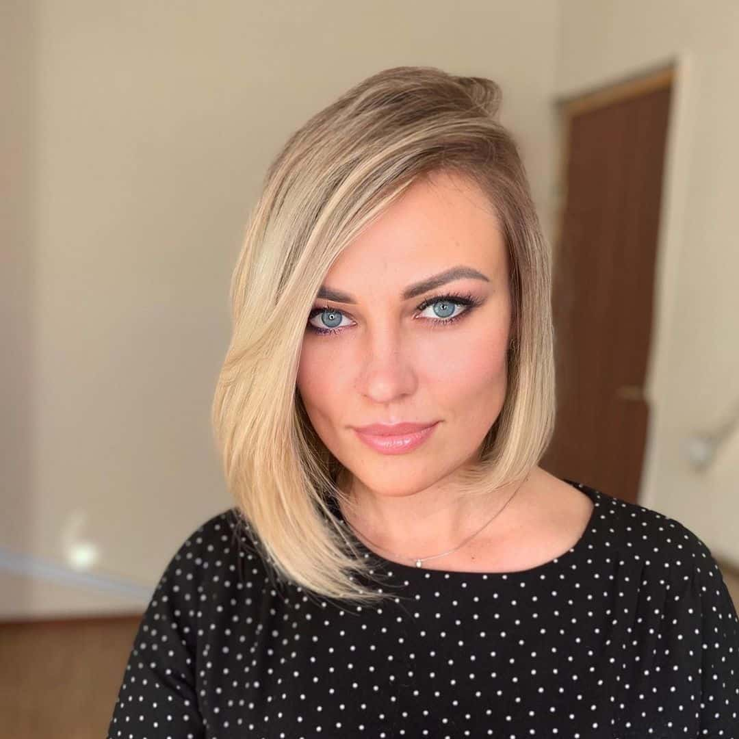 Short Blonde Asymmetrical Bob Haircut