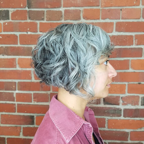 A graduated short angled bob haircut for for older women with grey hair