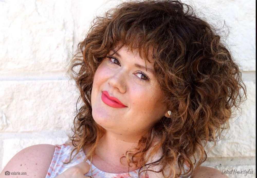 18 Best Short Curly Hair With Bangs To Try This Year