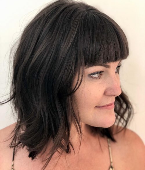 Short Layered Haircut with Blunt Bangs