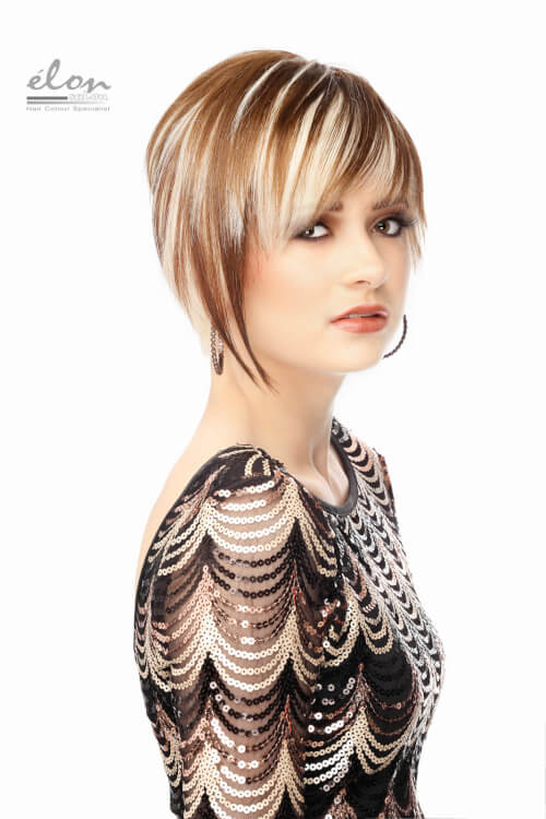 A bold haircut with blonde highlights