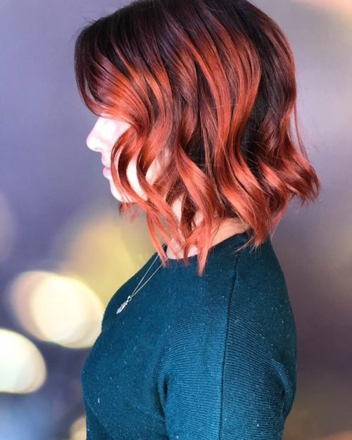 short wavy haircut with copper red hair