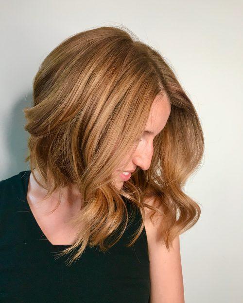 Shoulder-length strawberry blonde hair
