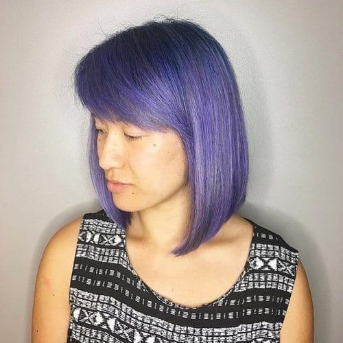A elegant short purple haircut with side bangs