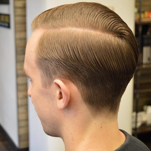 Side part hair with taper fade