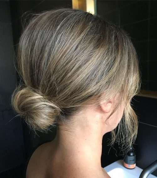 Picture of simple airy textured bun formal easy updo