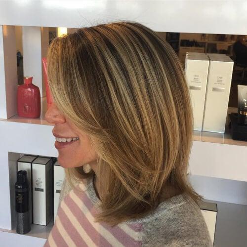 A simple thick shoulder-length hair cut