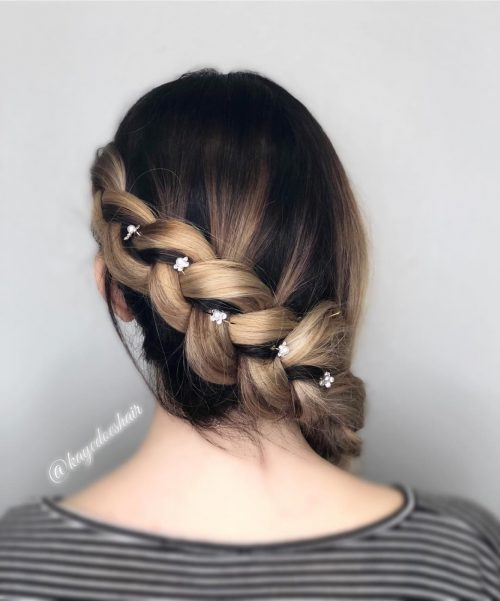 Picture of a simple with flower pins on a French braid