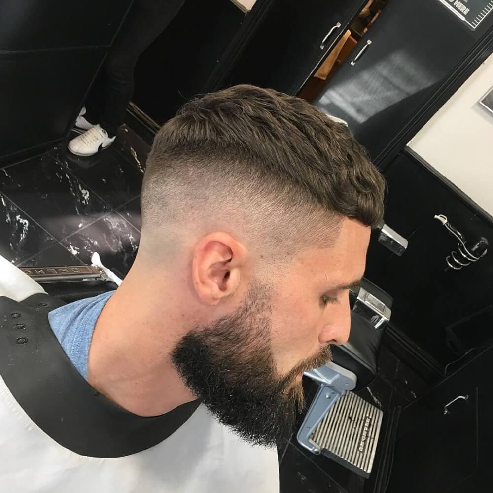 A caesar cut with a skin fade