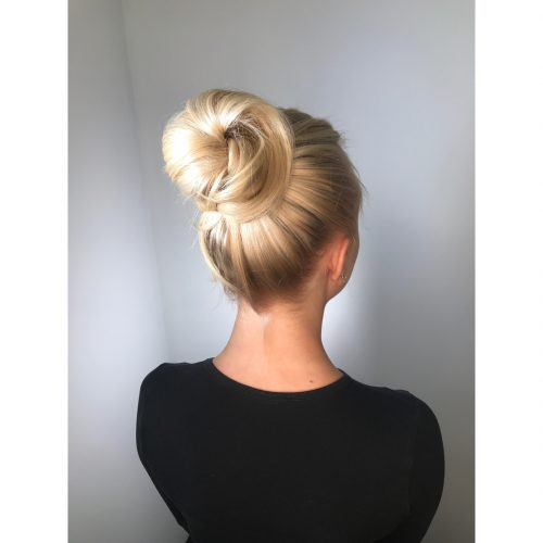 Picture of a smooth and big bun simple updo