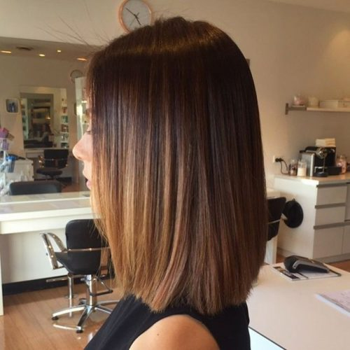 Cool shoulder-length haircut with dark brown hair
