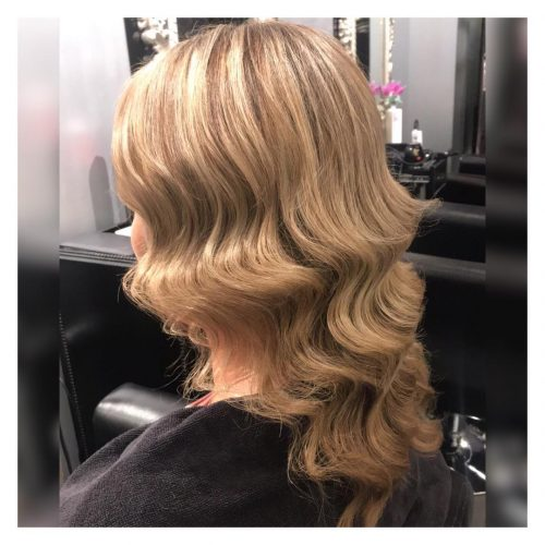 Picture of a soft and structured vintage waves party hairstyle