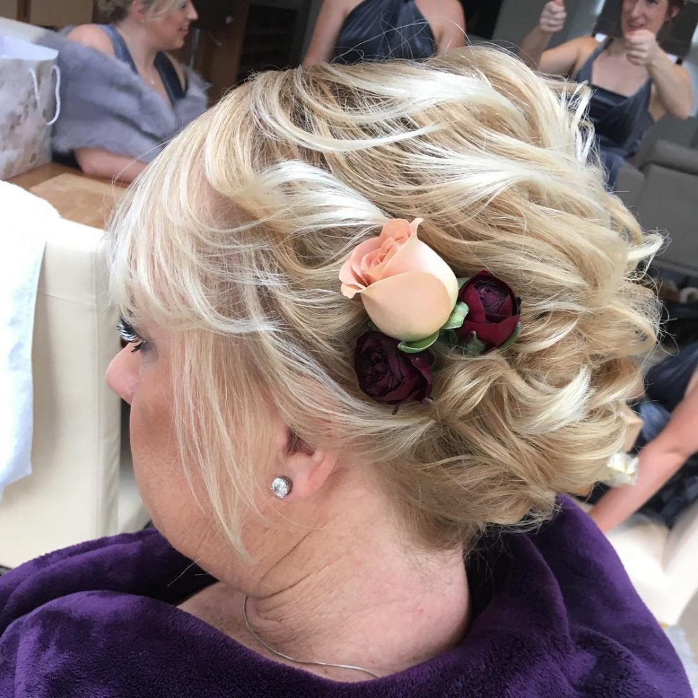 Soft updo with a rose flower
