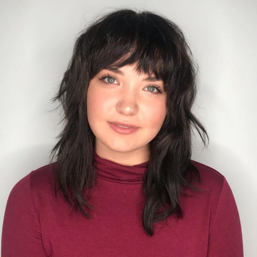 straight shoulder length shag with bangs