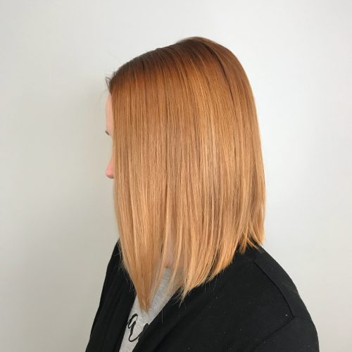 Picture of a strawberry copper angled shoulder length bob