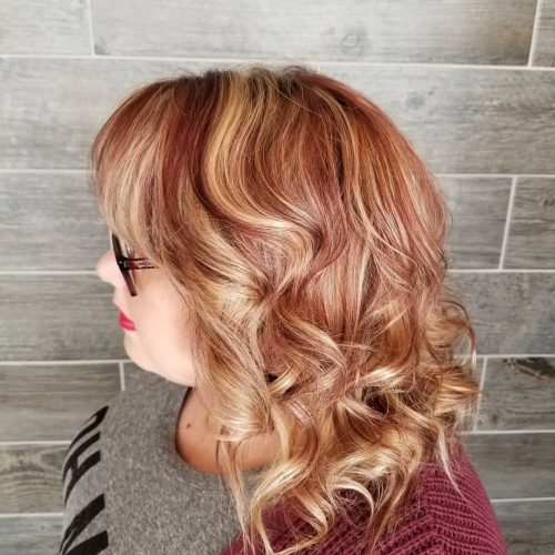 Picture of a strawberry swirls curled hair