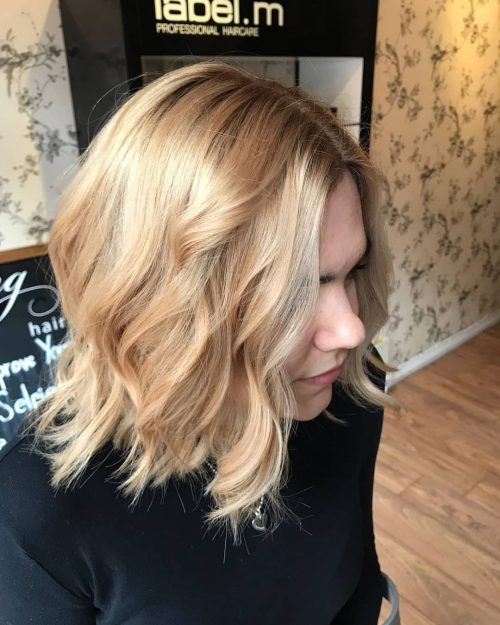 Picture of a stunning golden brown shoulder length bob locs