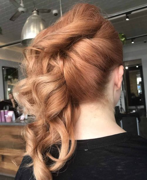 Picture of a stylish side swept updo with blonde highlights