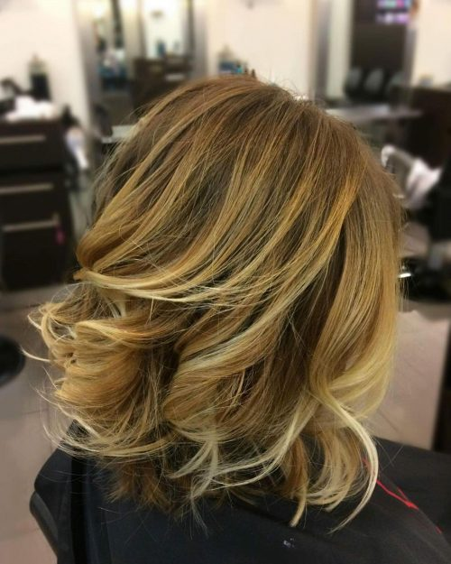 Picture of a sunset blonde with shoulder length layers