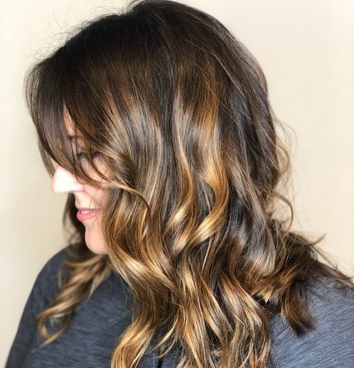 Picture of a sweet caramel hair and side bangs for heart shaped faces