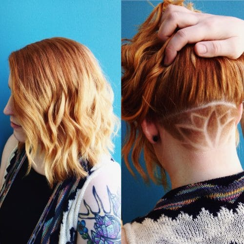 Tattooed undercut on wavy shoulder length hair