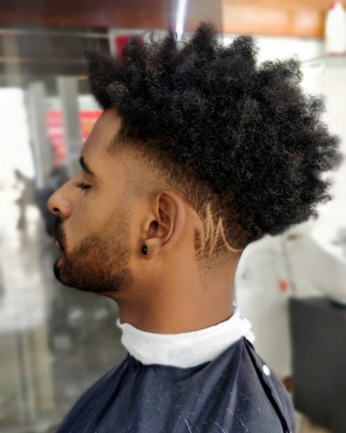 17 Best Curly Hair Fade Haircuts For Guys In 2021