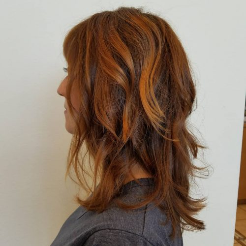 Picture of a textured chestnut shoulder length hair