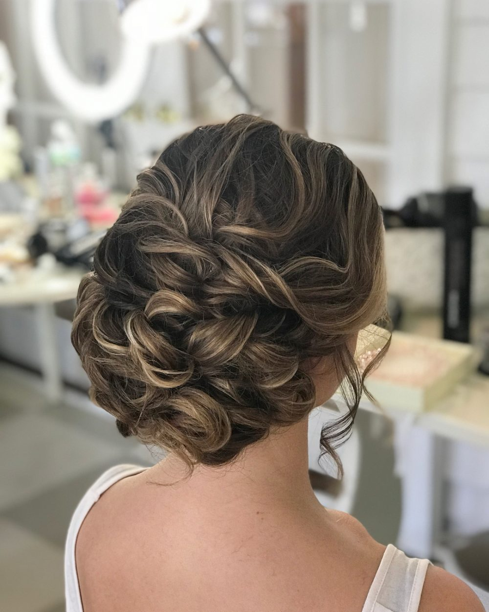 Textured Middle Height Bun hairstyle