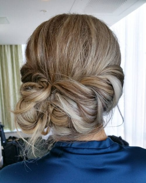 25 most beautiful updos for medium length hair new for 2018 textured loose updo hairstyle solutioingenieria Image collections