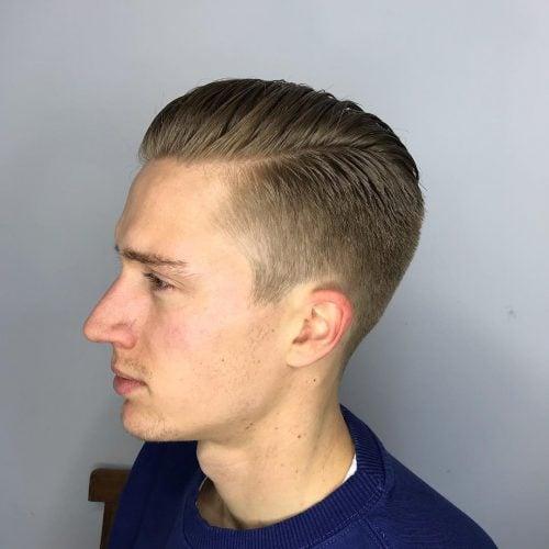 El caballero clásico con el pelo corto.
