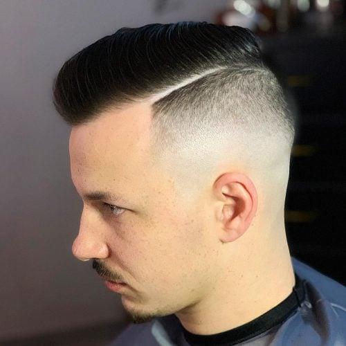 El corte de pelo de la Ivy League con decoloración de la piel.