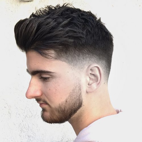 A mid-fade haircut for men with thick hair