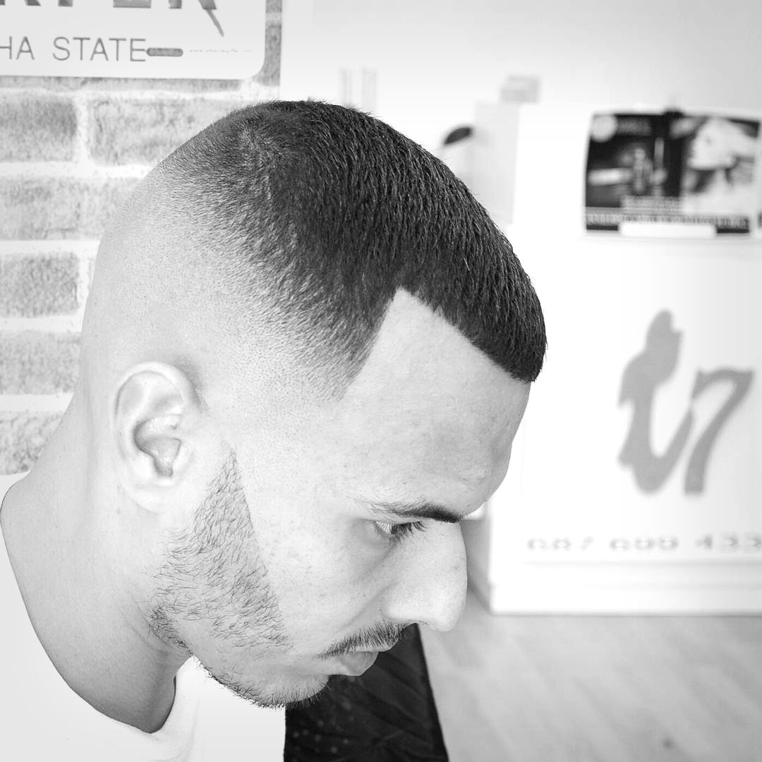 A tight faded haircut for men