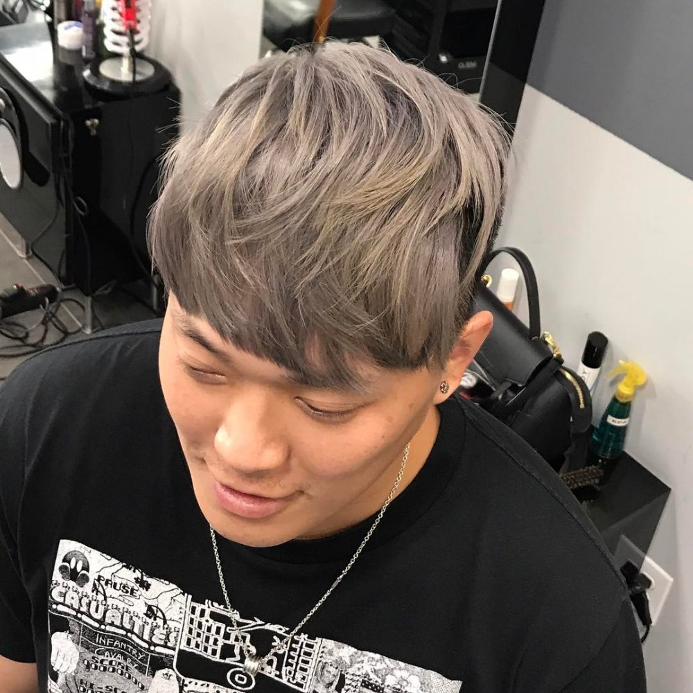 A trendy ash grey hair color