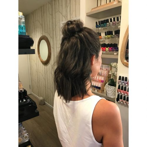 Picture of a trendy top messy bun shoulder length hair