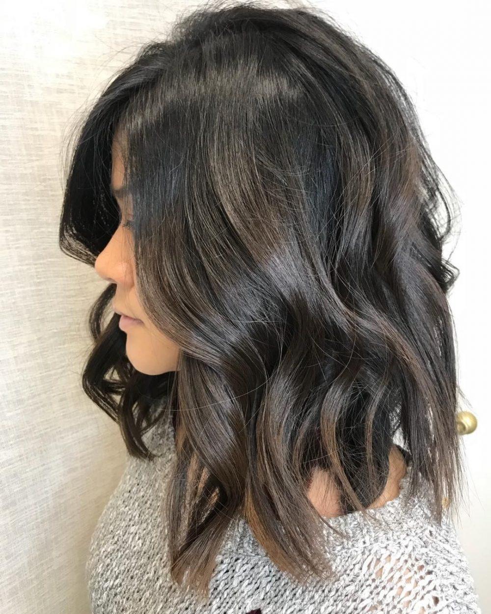 A versatile dark brown shoulder length layered bob