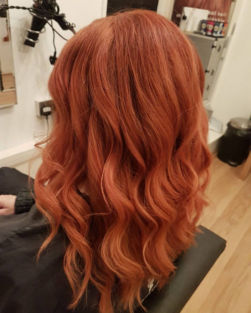 Vibrant and elegant waves with a red hair color